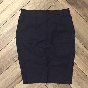 Navy pencil skirt with gold zipper